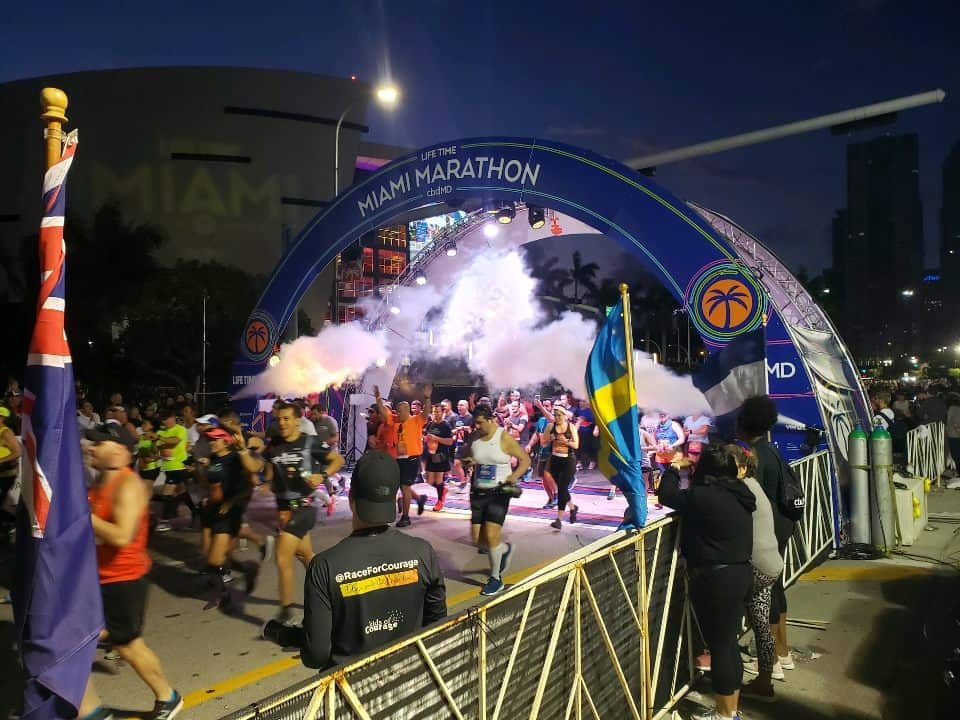 2020 Miami Marathon Start Line - Displays the production of the present to determine if a bigger event is necessarily better.